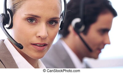 Young businesswoman talking with her headset