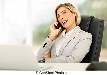 young businesswoman using telephone