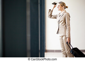 businesswoman waiting for flight at airport - young...