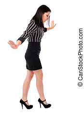 Young businesswoman walking on imaginary rope
