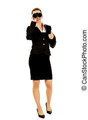 Young businesswoman with a binocular.