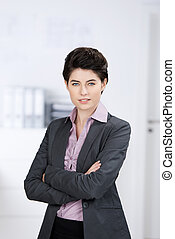 Young Businesswoman With Arms Crossed Standing In Office