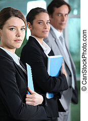 Young businesswoman with colleagues