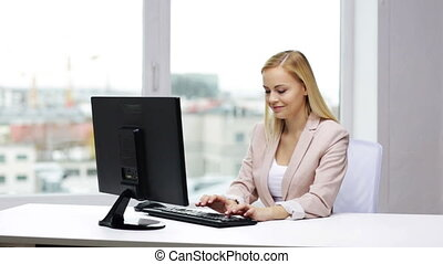 young businesswoman with computer typing at office