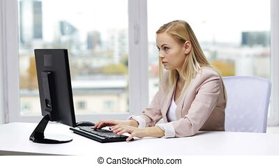 young businesswoman with computer typing at office -...