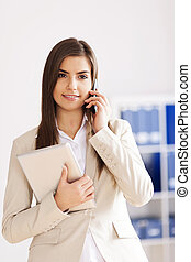 Young businesswoman with digital tablet and mobile phone