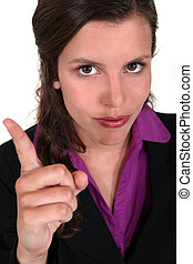 young businesswoman with her finger up