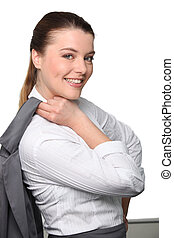 Young businesswoman with jacket over shoulder