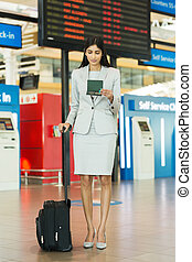 young businesswoman with luggage at airport