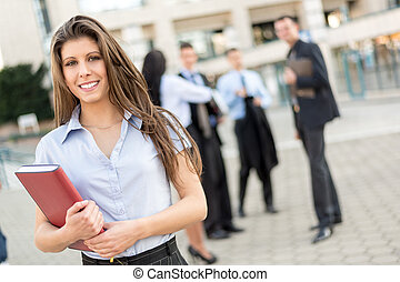 Young Businesswoman With Planner - Young businesswoman with...