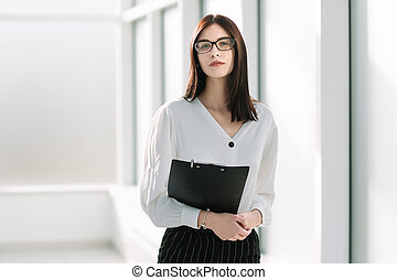 young businesswoman with standing in a bright office