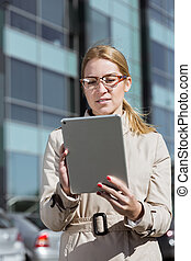 Young businesswoman with tablet
