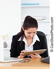 Young businesswoman with touchpad