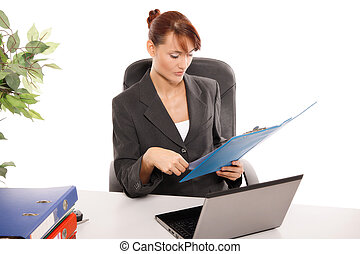 Young businesswoman working at desk