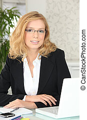young businesswoman working in her office