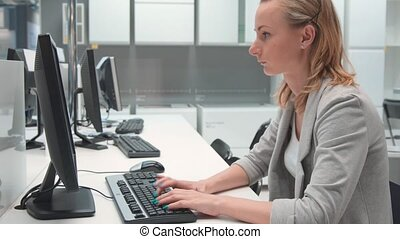 Young businesswoman working on computer in the office