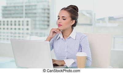 Young businesswoman working on her laptop