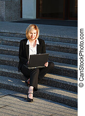 Young businesswoman working on laptop