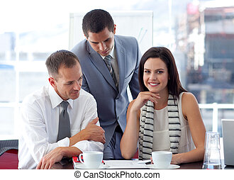 Young businesswoman working with colleagues