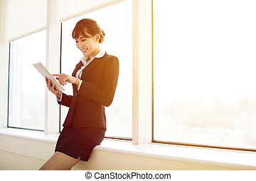 young   businesswoman working with tablet in the office