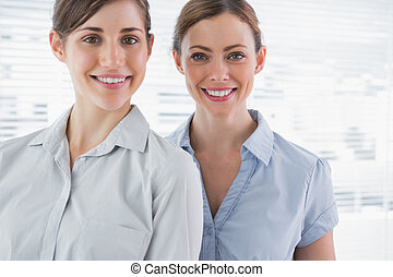 Young businesswomen smiling