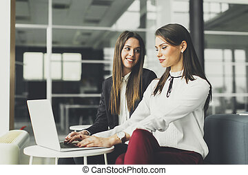 Young businesswomen working in the modern office