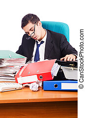 Young busy businessman at his desk