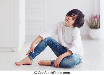 young calm boy, anime character, sitting barefoot on the floor