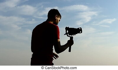Young cameraman shoots somebody with a steadicam in slo-mo