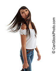 Young carefree woman flicking hair
