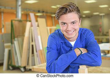 young carpenter smiling