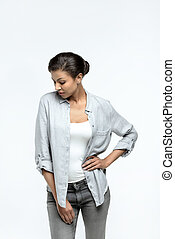 young casual african american woman posing isolated on white