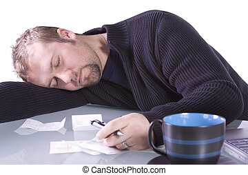 Young Casual Businessman Sleeping at his Desk