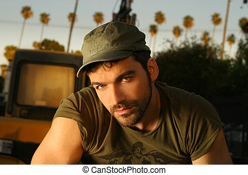 Young casual good looking man outdoors