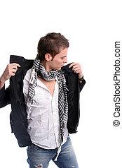 Young casual man, dressing his coat