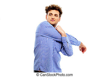 Young casual man stretching hand isolated on a white background