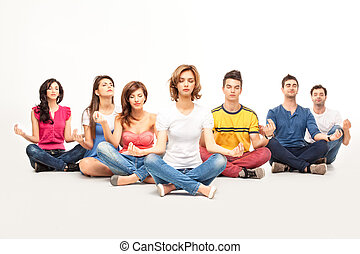 young casual people at yoga course - people siting in lotus...