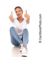 young casual seated woman making the ok sign