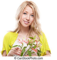 young casual smiling blond woman holding flowers