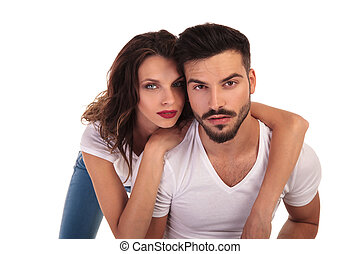 young casual woman leaning on her man