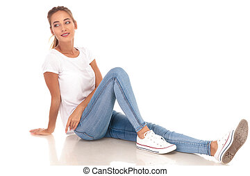 young casual woman looks to side while resting