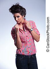 young casual woman pulling her collar