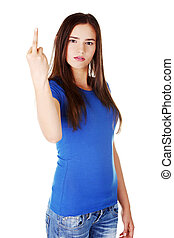 Young casual woman showing middle finger.