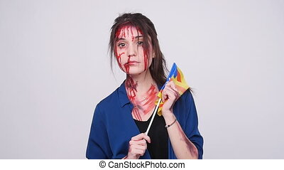 Young catalan woman with beatings and blood with estelada...
