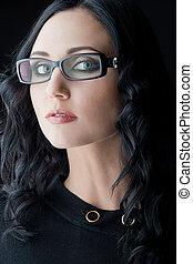 young caucasian brunette wearing glasses, close-up studio shot