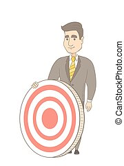 Young caucasian businessman and dart board. - Caucasian...