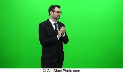 Young Caucasian Businessman Applauding Against Green Screen....