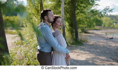 Young caucasian couple pose to photographer