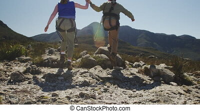 Young Caucasian couple running in zip lining equipment - ...