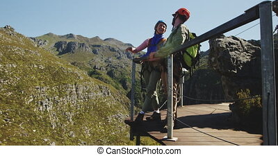 Young Caucasian couple talking - Side view of young...